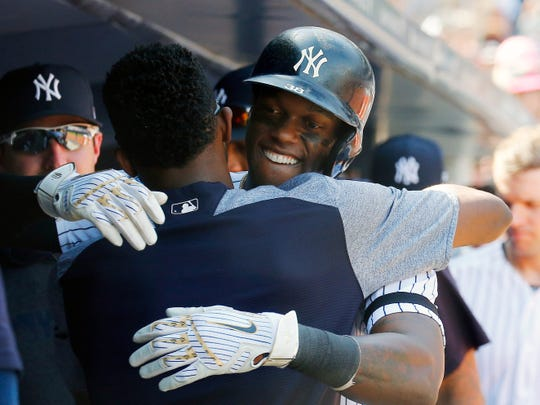 Aug 12, 2019; Bronx, NY, USA; New York Yankees right fielder Cameron Maybin (38) is congratulated by pitcher Domingo German (55) after hitting a solo home run against the Baltimore Orioles during the sixth inning of game one of a doubleheader at Yankees Stadium. Mandatory Credit: Andy Marlin-USA TODAY Sports