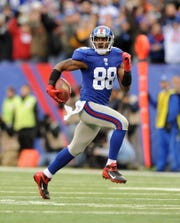 In this 2012 photo, New York Giants wide receiver Hakeem Nicks (88) burns Atlanta Falcons defensive end Kroy Biermann (71) en route to his second score of the day during Sunday's win over the Atlanta Falcons at MetLife Stadium.