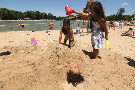 You can bury yourself in sand on the beach and take a refreshing swim in Darlington Lake in Darlington County Park.