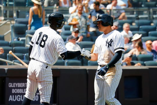 New York Yankees third baseman Gio Urshela (29) is congratulated by shortstop Didi Gregorius (18) after hitting a solo home run against the Baltimore Orioles during the fifth inning of game one of a doubleheader at Yankees Stadium.