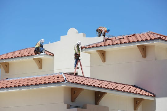 Construction workers scramble to complete work on New Mexico State University's newest residence hall, Juniper Hall, Monday Aug. 12, 2109. The 300-bed dormitory may not be open by the start of school.