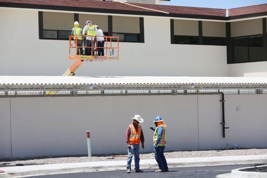 Construction continues on New Mexico State University's new art building, Devasthali Hall, Monday Aug. 12, 2019. Officials said Devasthali Hall should be complete by the start of school on Wednesday, Aug. 21.