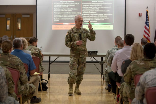 Maj. Gen. Ronald Place, Defense Health Agency acting assistant director for healthcare administration, briefs 49th Medical Group Airmen on the DHA transition, Aug. 8, 2019, on Holloman Air Force Base, N.M. Place visited to ensure 49 MDG Airmen understand how the changes will affect medical group operations.