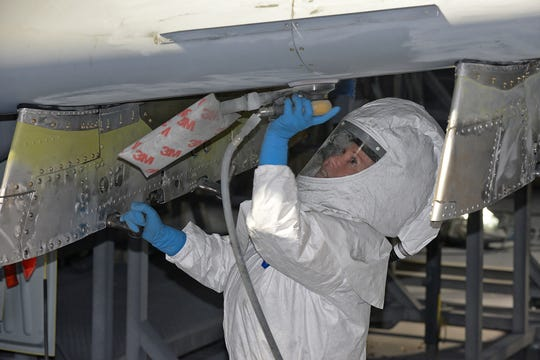 576th Aircraft Maintenance Squadron corrosion control painter Kimberly Hight sands down the underside of the new wing on A-10 Thunderbolt II, tail no. 80-0252, at Hill Air Force Base, Utah, June 28, 2019. The aircraft was the last of 173 A-10s to receive new wings under the Enhanced Wing Assembly program to extend the flying service life of the fleet.