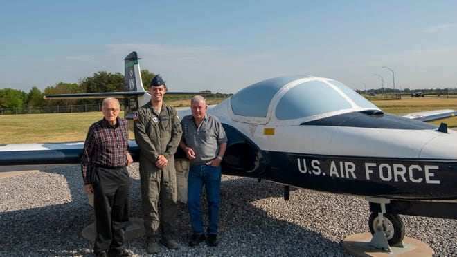 2nd Lt. Joe Stara, center, a student pilot currently assigned to the 71st Student Squadron, poses by a T-37 Tweet with retired Col. Jim Faulkner, left, and retired Lt. Col. Jim Mayhall, Aug. 6, at Vance Air Force Base, Okla. Faulkner and Mayhall were both student pilots at Vance AFB in the late 1960s.