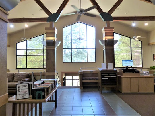 The entrance to the library features a spectacular view of Sierra Blance Peak.