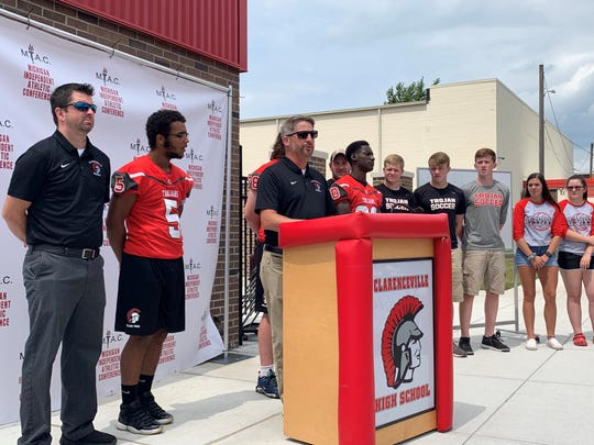 Clarenceville football coach Bob Meyer speaks to the crowd at MIAC media day.