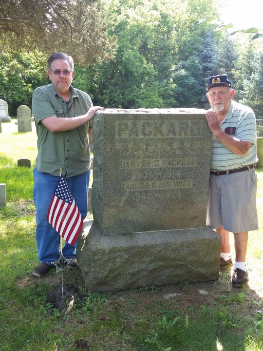 Mike Tavarozzi and Bill Eaton, members of Sons of Union Veterans of the Civil War, are honoring Harvey C. Packard, buried in Lapham Cemetery.