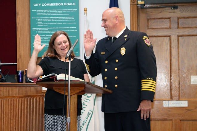 On the right, Paul Wells is the new chief of the Birmingham Fire Department.