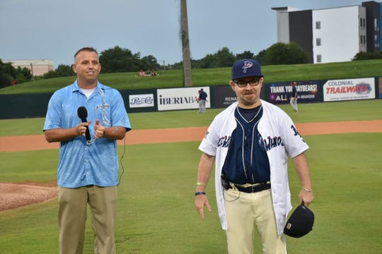 Blue Wahoos team president Jonathan Griffith presents a jersey to Mobile BayBears batboy Wade Vadakin in a pregame ceremony Saturday to announce he will join Pensacola's team next year.