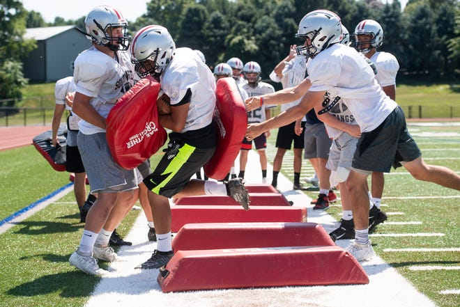 South Western football players run through ball security drills on the first day of fall sports practice in Hanover on Monday, August 12, 2019.