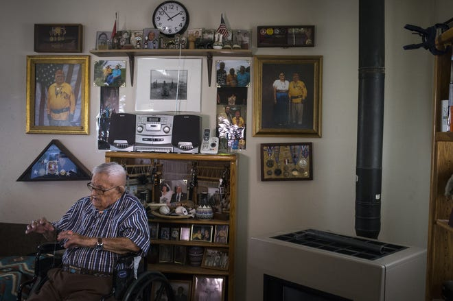 Navajo Code Talker Samuel Sandoval talks about serving in the U.S. Marine Corps during World War II on July 7, 2019, at his home in Shiprock, New Mexico.