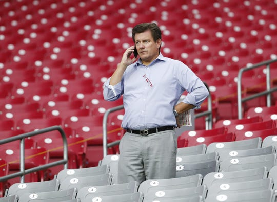 Arizona Cardinals president Michael Bidwill talks on his phone while watching training camp at State Farm Stadium July 31, 2019.