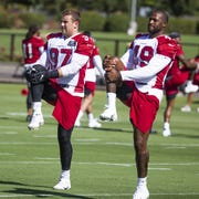 Rookie Zach Allen (left) is now No. 1 on the Arizona Cardinals' depth chart at his position.