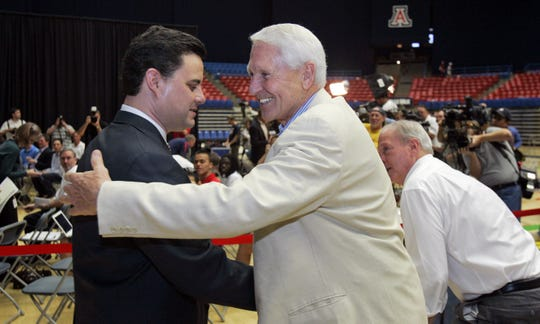 Arizona basketball coach Sean Miller (left) greets former coach Lute Olson before a news conference to introduce Miller at McKale Center in Tucson on April 7, 2009.