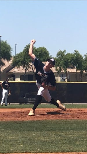 Tyler Davis pitches for the Arizona Athletics club team.
