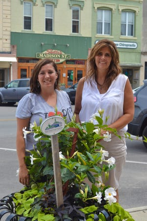 Since 2013, Main Street Port Clinton has distributed about $110,000 in grant money which funded exterior improvements to downtown businesses. Shown here are Main Street Port Clinton Operations Manager Nicole Kochensparger and Executive Director Nikki Adams.