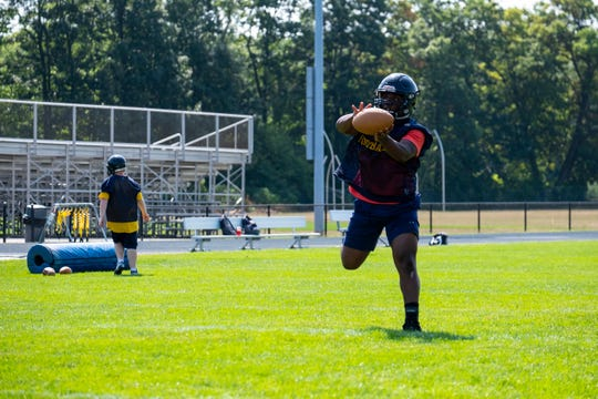 Port Huron Northern linebacker John Young makes a catch during the team's first practice Monday, Aug. 12, 2019, at Port Huron Northern High School.