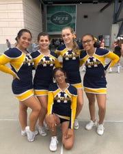 Highland High School cheerleaders pose at MetLife Stadium last year.