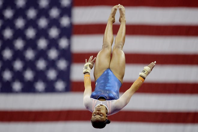 Trinity Thomas competes on the vault at the U.S. Gymnastics Championships on Friday, Aug. 9, 2019, in Kansas City, Mo. (AP Photo/Charlie Riedel)