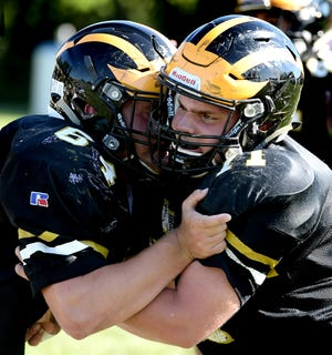 Red Lion defensive tackle Joe Jefferis works out against a teammate during a recent practice. The Lions and all of the other players in the York-Adams League will finally get a chance to hit an opponent in a real game on Friday night.