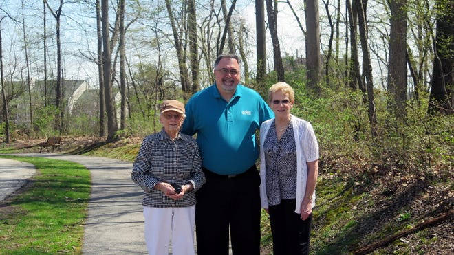 From left: Normandie Ridge resident Eunice Knowles, Executive Director Chad Mondorff and Normandie Ridge resident Susan Martin standing near the trail
