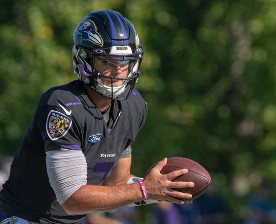 Trace McSorley hands the ball off during Ravens training camp in Owings Mills, Maryland.