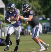 Trace McSorley, right, runs the offense during Ravens training camp in Owings Mills, Maryland.