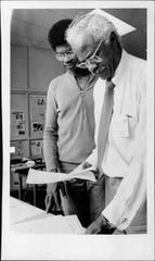 "Howard Coles, editor and publisher of Frederick Douglass Voice, with Les Hedman during summertime ""Third Ward Beat"" program for teenagers interested in journalism."