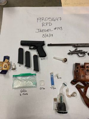 Police said guns and drugs were found a silver sedan after a traffic stop in Redding on Aug. 12, 2019.