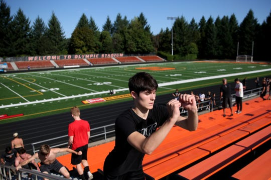 Football players jump stairs at a practice before the season starts at Sprague High School in Salem on Aug. 12, 2019.