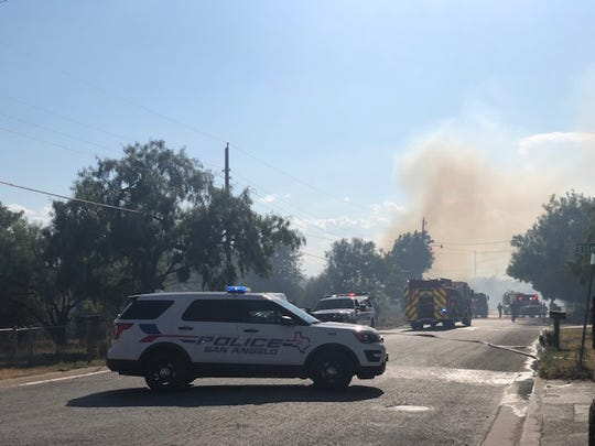 San Angelo police block off the road for the grass fire Monday afternoon