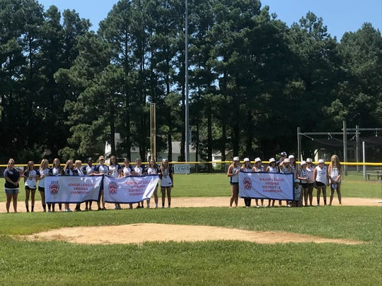 The Senior Girls state champions and Major League Girls District 8 champions from Central Accomack Little League stand on the field during a celebration in Onancock, Virginia on Sunday, Aug. 11, 2019.