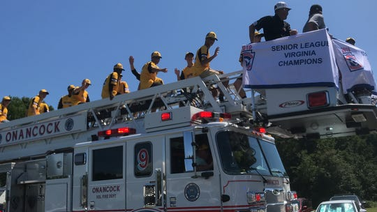 Senior League Virginia and Southeast Region champions from Central Accomack Little League ride atop a fire truck during a parade in Onancock, Virginia on Sunday, Aug. 11, 2019, celebrating successes of the Central Accomack Little League. The Senior Boys team also placed fourth in the nation in the Senior League Baseball World Series.