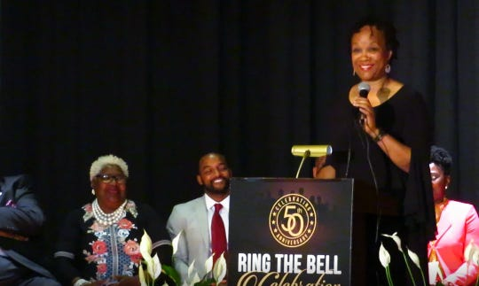 Carolyn Jones reflects on her elementary school years as the keynote speaker Monday during the Ring the Bell Celebration at Booker T. Washington High School