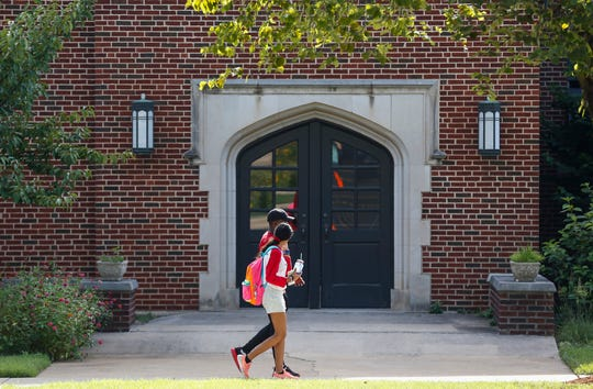 Students walk on campus at Drury University on Monday, Aug. 12, 2019, in Springfield, Mo.