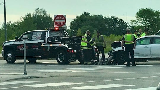 A tow-truck crew works to clear one of four vehicles involved in a collision Monday morning that snarled traffic at Minnesota Hwy. 15 and Stearns County Road 1 in Sartell.