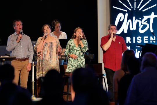 Sean Stafford, Sandy Watts, Anna Hickey and Bill Gwaltney lead the Killearn United Methodist Church congregation in song Sunday, August 11, 2019.