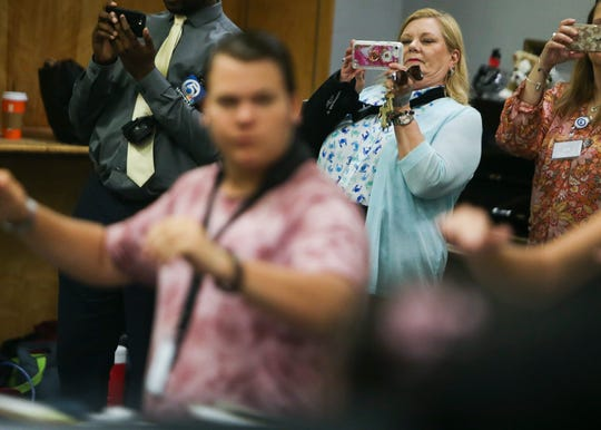 Martin County school Superintendent Laurie Gaylord takes photographs as band students practice as Gaylord visits South Fork High School students and faculty during their first day of school on Monday, August 12, 2019, in Martin County. Gaylord's second term ends in November. The district will appoint her successor.