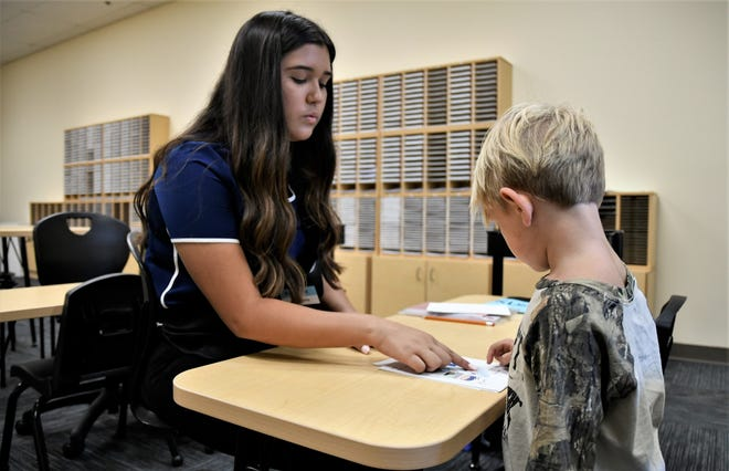 Katrina Ortiz instructs 4-year-old Tucker McDougal at Kumon of Visalia on Monday, Aug. 12, 2019.