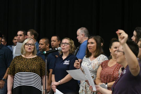 "VUSD's staff choir led a nearly-full Convention Center auditorium in a singalong of Bobby McFerrin's ""Don't Worry Be Happy"" at the district's annual convocation ceremony on Aug. 12, 2019."