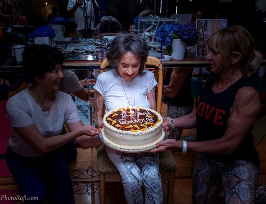 Tao Porchon Lynch, the world's oldest yoga teacher, celebrates her 101st birthday with friends.