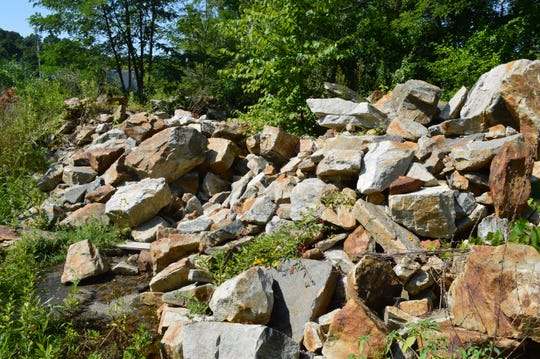 Carmel Town Board member Mike Barile owns the rocks that are involved in the town's land deal with Tompkins Mahopac Bank, said town Supervisor Ken Schmitt.