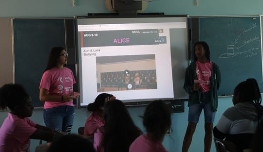 From left, Laila Issa and Zuri Jackson talk about their coding project that deals with bullying during the AT&T & NSSA Girls of Color Coding Camp program at Benjamin Turner Middle School in Mount Vernon Aug. 9, 2019.