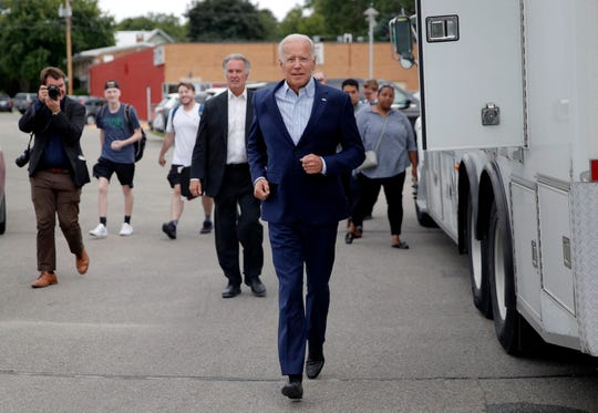 Former Vice President and Democratic presidential candidate Joe Biden runs into the building before speaking at the Iowa Democratic Wing Ding at the Surf Ballroom, Friday, Aug. 9, 2019, in Clear Lake, Iowa.