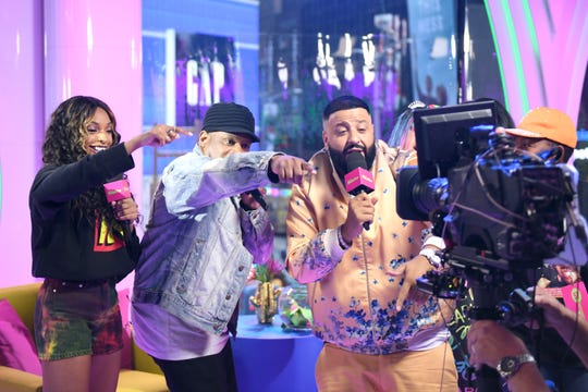 "Jamila Mustafa, Sway Calloway and DJ Khaled speak to the camera as ""MTV Presents: Khaled Con,"" a DJ Khaled-hosted fan event in MTV's Times Square Studio, celebrating the release of ""Father Of Asahd"" at MTV Studios on May 17, 2019 in New York City."