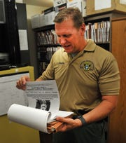 Wichita Falls Police Department, detective John Laughlin looks through one of several cold-case files the department has assigned him to investigate, Monday afternoon. WFPD spokesperson, officer Jeff Hughes said, in an emailed media statement, that the department had made some changes and assigned a full time detective to look at their Cold Cases.