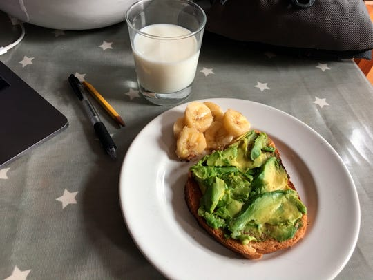 This July 31, 2019 photo shows avocado toast, banana and a glass of milk on a table in the Brooklyn borough of New York. Whole grain toast with avocado is a fast but nutritious school-morning breakfast, and parents can add a hard-boiled egg for extra protein. (Melissa Rayworth via AP)