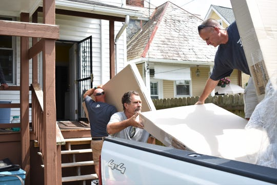 Malouf employees unload 10 mattresses and accessories Monday at Transitions, a domestic violence shelter in Zanesville.