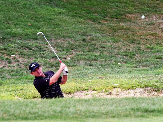 Brad Baker hits from a bunker during the second round of the Zanesville District Golf Association Senior Amateur on Sunday at EagleSticks. Baker shot 71 to take a four-shot lead into the final round.